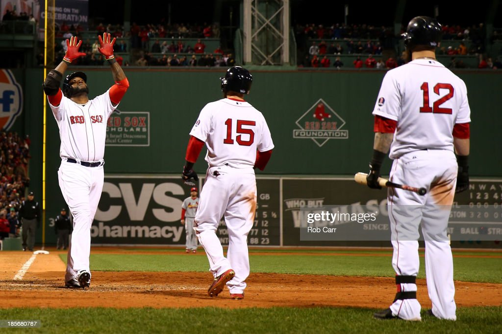 <a gi-track='captionPersonalityLinkClicked' href=/galleries/search?phrase=David+Ortiz&family=editorial&specificpeople=175825 ng-click='$event.stopPropagation()'>David Ortiz</a> #34 of the Boston Red Sox celebrates with <a gi-track='captionPersonalityLinkClicked' href=/galleries/search?phrase=Mike+Napoli&family=editorial&specificpeople=525007 ng-click='$event.stopPropagation()'>Mike Napoli</a> #12 and <a gi-track='captionPersonalityLinkClicked' href=/galleries/search?phrase=Dustin+Pedroia&family=editorial&specificpeople=836339 ng-click='$event.stopPropagation()'>Dustin Pedroia</a> #15 after hitting a home run in the seventh inning against the St. Louis Cardinals during Game One of the 2013 World Series at Fenway Park on October 23, 2013 in Boston, Massachusetts.