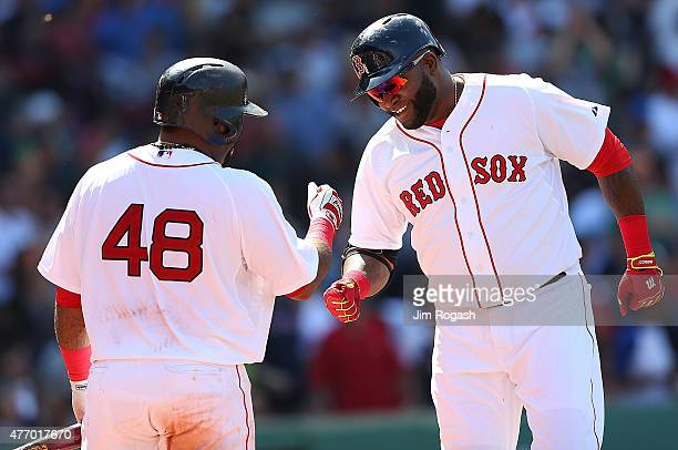 David Ortiz of the Boston Red Sox celebrates with Pablo Sandoval after hitting a home run against the Toronto Blue Jays in the sixth inning at Fenway...