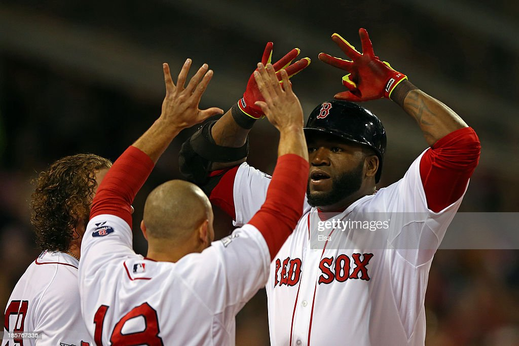 <a gi-track='captionPersonalityLinkClicked' href=/galleries/search?phrase=David+Ortiz&family=editorial&specificpeople=175825 ng-click='$event.stopPropagation()'>David Ortiz</a> #34 of the Boston Red Sox celebrates with <a gi-track='captionPersonalityLinkClicked' href=/galleries/search?phrase=Shane+Victorino&family=editorial&specificpeople=576251 ng-click='$event.stopPropagation()'>Shane Victorino</a> #18 after hitting a two run home run in the sixth inning against the St. Louis Cardinals during Game Two of the 2013 World Series at Fenway Park on October 24, 2013 in Boston, Massachusetts.