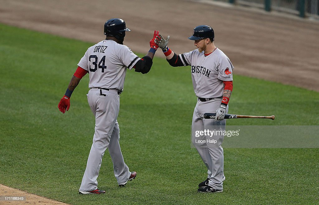 David Ortiz #34 of the Boston Red Sox celebrates with teammate Mike Carp #37 after hitting a solo home run in the first inning of the game against the Detroit Tigers at Comerica Park on June 22, 2013 in Detroit, Michigan.