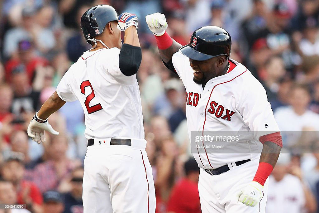 <a gi-track='captionPersonalityLinkClicked' href=/galleries/search?phrase=David+Ortiz&family=editorial&specificpeople=175825 ng-click='$event.stopPropagation()'>David Ortiz</a> #34 of the Boston Red Sox celebrates with <a gi-track='captionPersonalityLinkClicked' href=/galleries/search?phrase=Xander+Bogaerts&family=editorial&specificpeople=9461957 ng-click='$event.stopPropagation()'>Xander Bogaerts</a> #2 after hitting a home run against the Colorado Rockies during the first inning at Fenway Park on May 26, 2016 in Boston, Massachusetts.