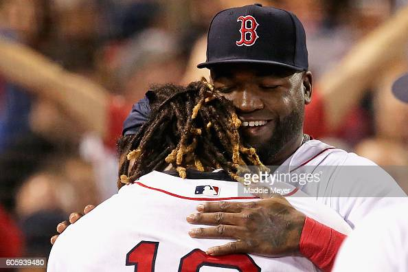 David Ortiz of the Boston Red Sox congratulates Hanley Ramirez after he hit the game winning three run homer during the ninth inning against the New...