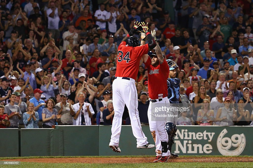<a gi-track='captionPersonalityLinkClicked' href=/galleries/search?phrase=David+Ortiz&family=editorial&specificpeople=175825 ng-click='$event.stopPropagation()'>David Ortiz</a> #34 of the Boston Red Sox congratulates <a gi-track='captionPersonalityLinkClicked' href=/galleries/search?phrase=Mike+Napoli&family=editorial&specificpeople=525007 ng-click='$event.stopPropagation()'>Mike Napoli</a> #12 after he hit a two run homer during the seventh inning against the Tampa Bay Rays at Fenway Park on July 31, 2015 in Boston, Massachusetts.