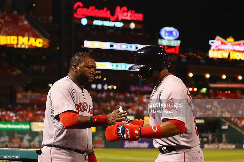 David Ortiz #34 of the Boston Red Sox congratulates Yoenis Cespedes #52 of the Boston Red Sox after Cespedes scored the game-winning run against the St. Louis Cardinals in the ninth inning at Busch Stadium on August 6, 2014 in St. Louis, Missouri. The Red Sox beat the Cardinals 2-1.