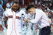 David Ortiz of the Boston Red Sox dunks Hanley Ramirez and NESN reporter Gary Striewski with Powerade after defeating the Baltimore Orioles 64 at...