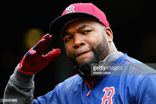David Ortiz of the Boston Red Sox enters the dugout after batting practice before the Red Sox home opener against the Baltimore Orioles at Fenway...