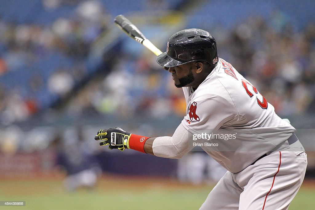 David Ortiz #34 of the Boston Red Sox follows through after hitting an RBI single off of pitcher Joel Peralta #62 of the Tampa Bay Rays to score Mookie Betts during the eighth inning of a game on August 31, 2014 at Tropicana Field in St. Petersburg, Florida.