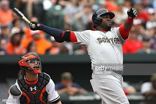 David Ortiz of the Boston Red Sox follows through on his swing as he hits a home run against the Baltimore Orioles during the eighth inning at Oriole...
