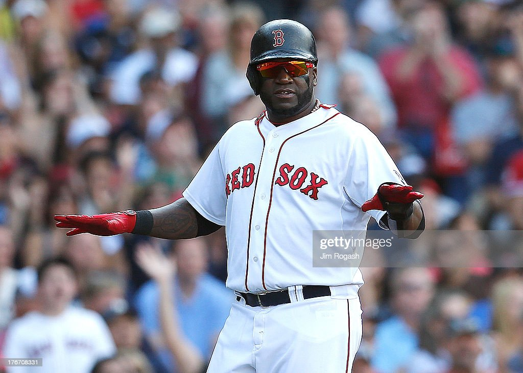 David Ortiz #34 of the Boston Red Sox gestures the safe sign after scoring in the against the New York Yankees in the 4th inning at Fenway Park on August 17, 2013 in Boston, Massachusetts.