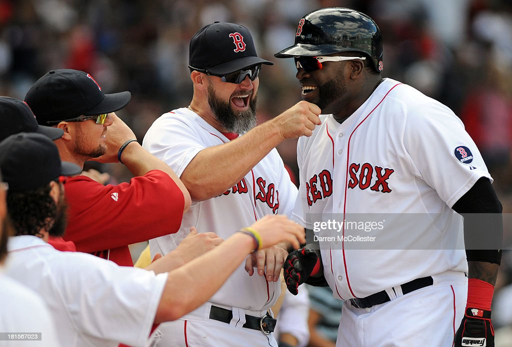 <a gi-track='captionPersonalityLinkClicked' href=/galleries/search?phrase=David+Ortiz&family=editorial&specificpeople=175825 ng-click='$event.stopPropagation()'>David Ortiz</a> #34 of the Boston Red Sox gets a rub on the chin from teamates after hitting a solo homerun in the sixth inning against the Toronto Blue Jays at Fenway Park on September 22, 2013 in Boston, Massachusetts.