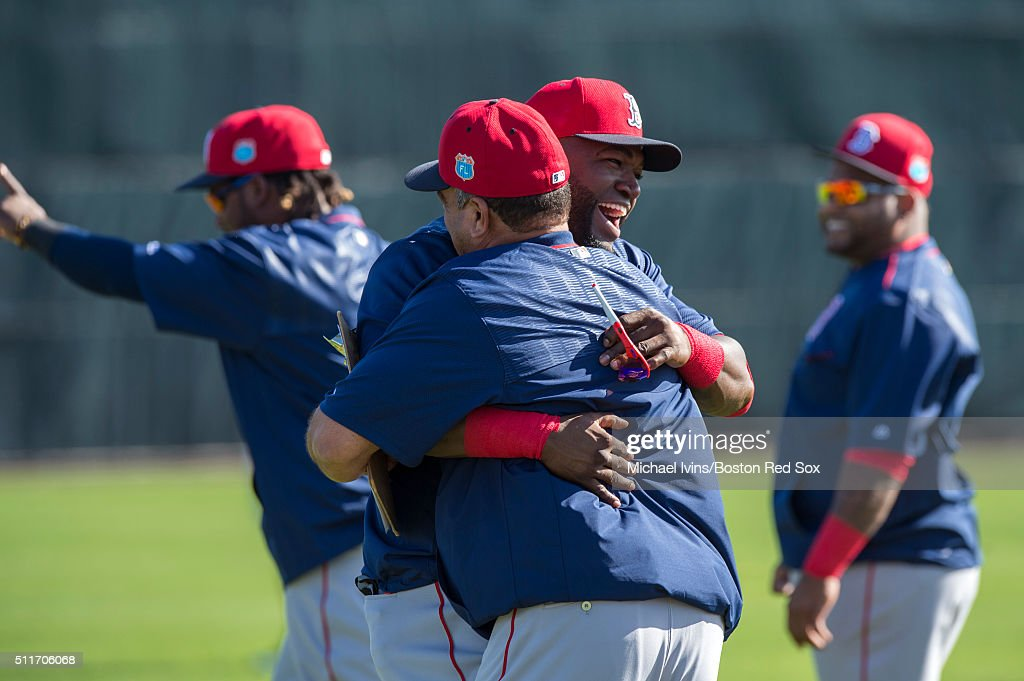 David Ortiz #34 of the Boston Red Sox gets assistant hitting coach Victor Rodriguez on February 22, 2016 at Fenway South in Fort Myers, Florida .