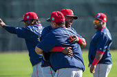 David Ortiz of the Boston Red Sox gets assistant hitting coach Victor Rodriguez on February 22 2016 at Fenway South in Fort Myers Florida
