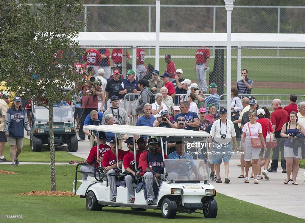 David Ortiz #34 of the Boston Red Sox got a ride off of the practice field with a group of teammates during a Spring Training workout at Fenway South on February 25, 2014 in Fort Myers, Florida.