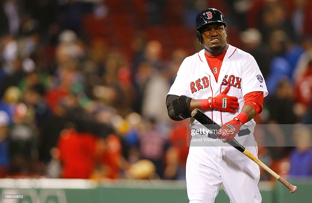 <a gi-track='captionPersonalityLinkClicked' href=/galleries/search?phrase=David+Ortiz&family=editorial&specificpeople=175825 ng-click='$event.stopPropagation()'>David Ortiz</a> #34 of the Boston Red Sox grabs his abdomen after grounding out to first base in the ninth inning against the Minnesota Twins during the game on May 9, 2013 at Fenway Park in Boston, Massachusetts.