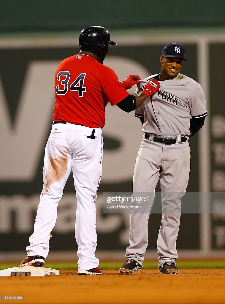 David Ortiz #34 of the Boston Red Sox grabs Robinson Cano #24 of the New York Yankees by the jersey at second base following a double during the game on July 19, 2013 at Fenway Park in Boston, Massachusetts.