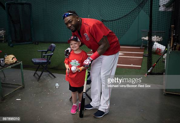 David Ortiz of the Boston Red Sox greets Jimmy Fund patient Layla Flint in the batting cages during the Red Sox 15th Annual WEEINESN Jimmy Fund Radio...