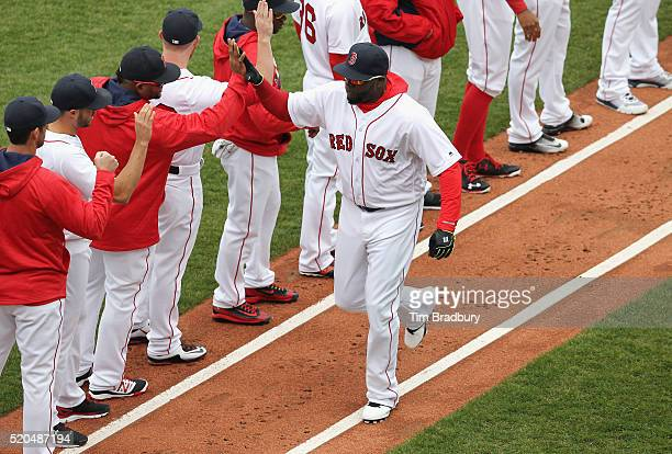 David Ortiz of the Boston Red Sox greets teammates as he is introduced prior to the home opener against the Baltimore Orioles at Fenway Park on April...