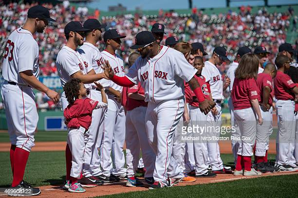 David Ortiz of the Boston Red Sox greets teammates during team introductions before the first inning against the Washington Nationals on Opening Day...
