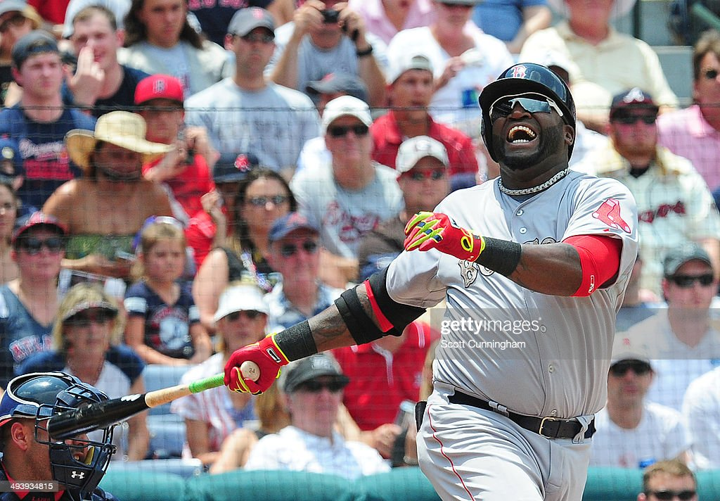 David Ortiz #34 of the Boston Red Sox grimaces after fouling a ball off of his foot during the 4th inning against the Atlanta Braves at Turner Field on May 26, 2014 in Atlanta, Georgia.