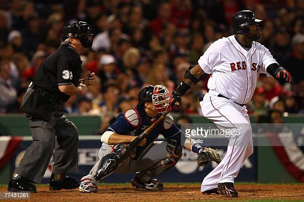 David Ortiz of the Boston Red Sox hits a double in the eighth inning against the Cleveland Indians during Game Six of the American League...