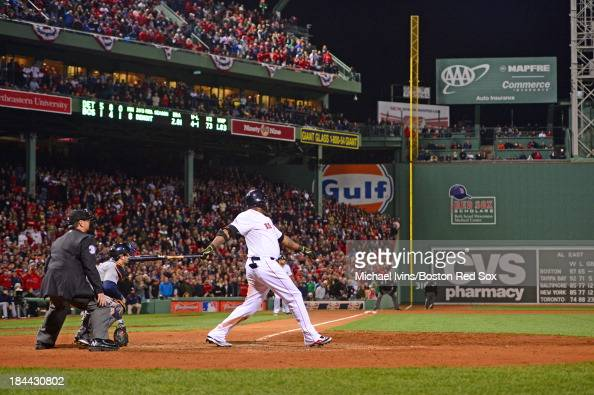 David Ortiz of the Boston Red Sox hits a grand slam home run against the Detroit Tigers in the eighth inning of Game Two of the American League...