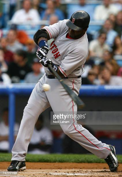 David Ortiz of the Boston Red Sox hits a single in the first inning against the New York Yankees on May 22 2007 at Yankee Stadium in the Bronx...