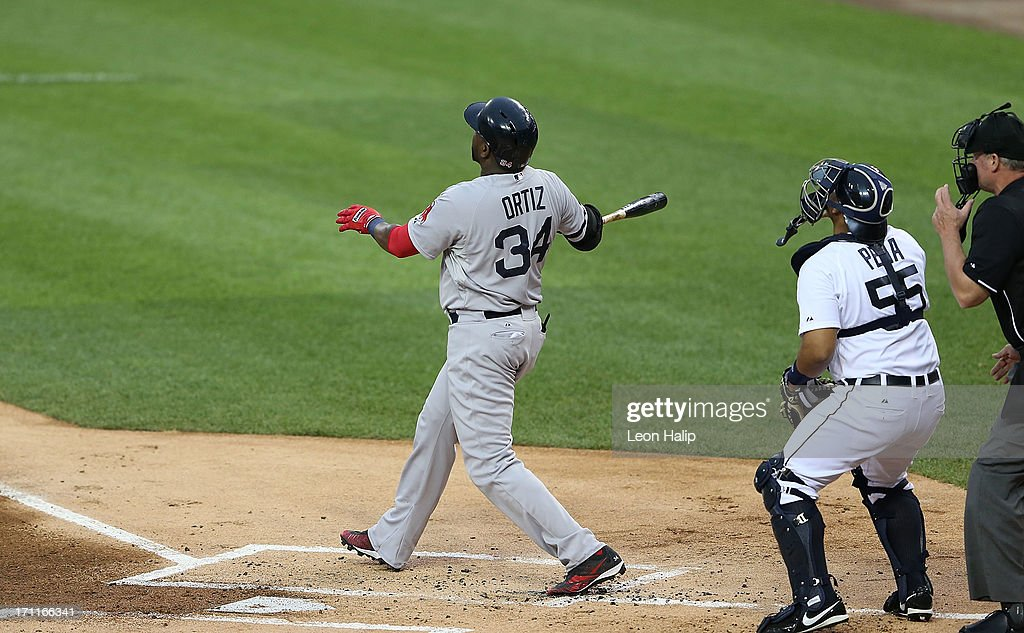 David Ortiz #34 of the Boston Red Sox hits a solo home run in the first inning of the game against the Detroit Tigers at Comerica Park on June 22, 2013 in Detroit, Michigan.