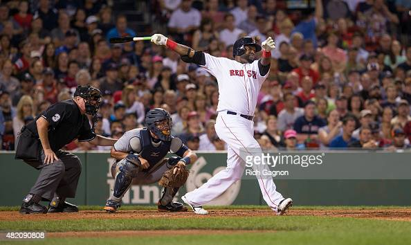 David Ortiz of the Boston Red Sox hits a threerun home run during the fifth inning against the Detroit Tigers at Fenway Park on July 26 2015 in...