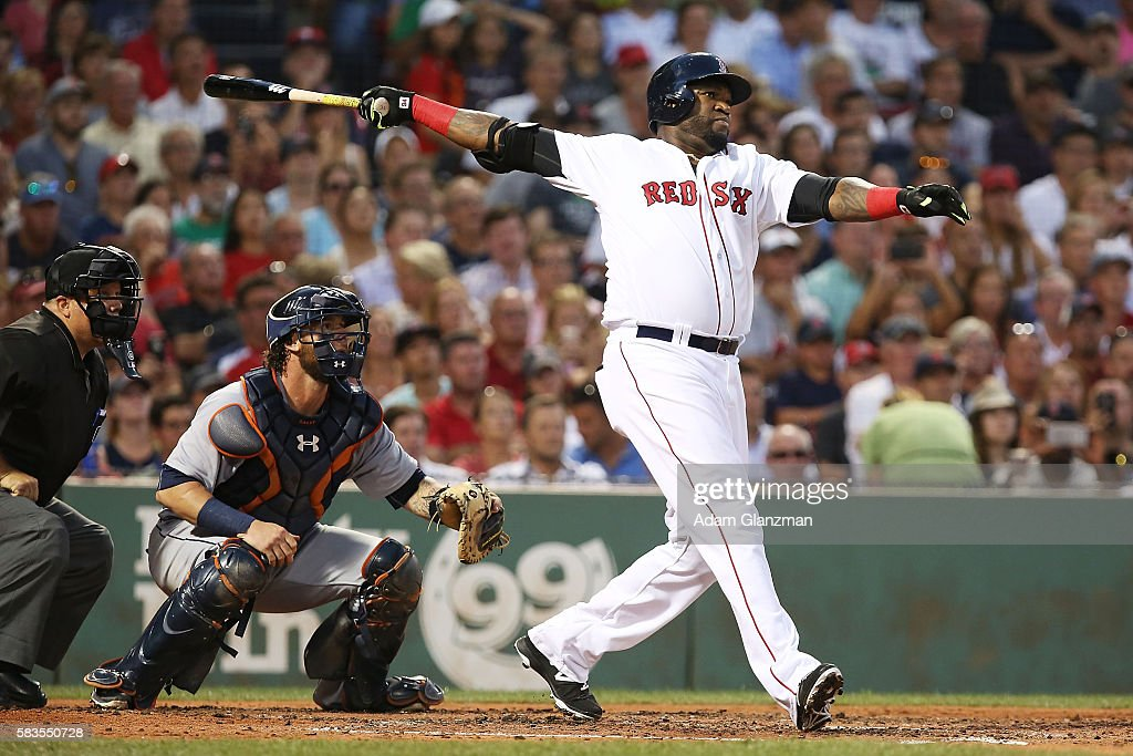 David Ortiz of the Boston Red Sox hits a threerun home run in the third inning during the game against the Detroit Tigers at Fenway Park on July 26...