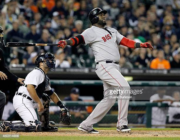 David Ortiz of the Boston Red Sox hits a threerun home run that gives the Red Sox a 53 lead with catcher Alex Avila of the Detroit Tigers in the...