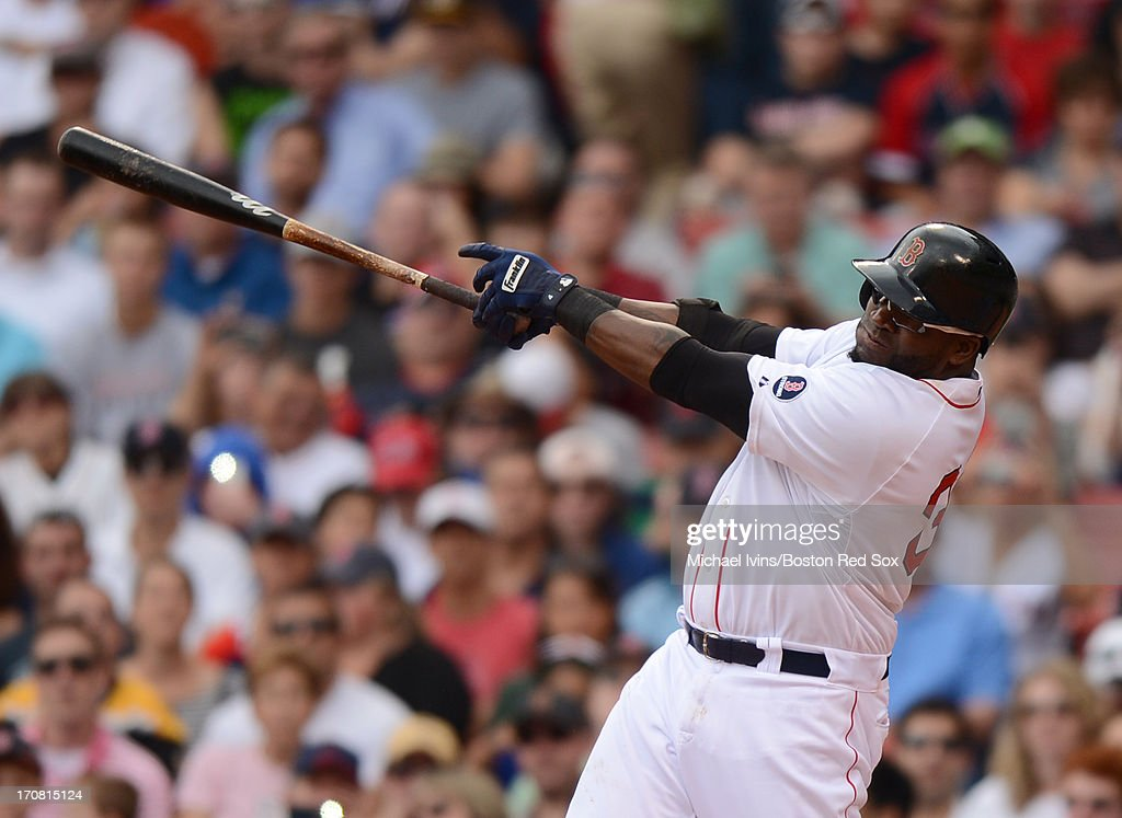 David Ortiz #34 of the Boston Red Sox hits a two RBI single against the Tampa Bay Rays in the third inning on June 18, 2013 at Fenway Park in Boston, Massachusetts.