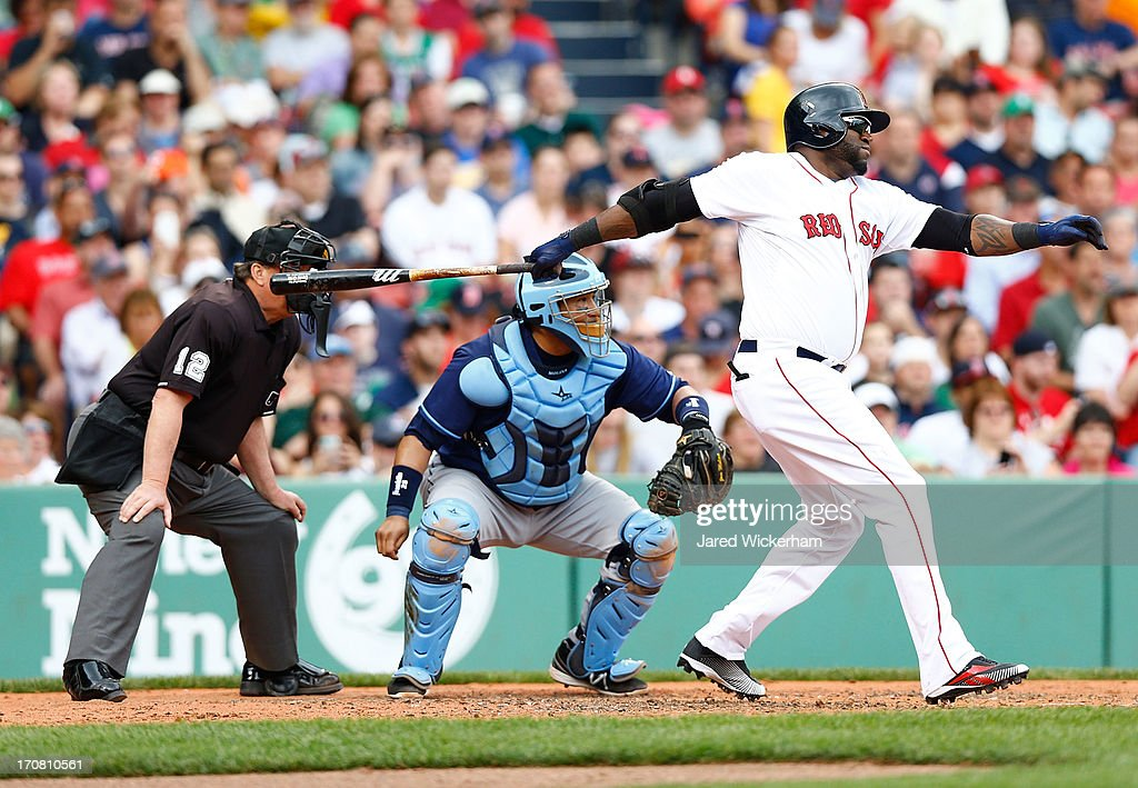 David Ortiz #34 of the Boston Red Sox hits a two-run single in the third inning against the Tampa Bay Rays during the game on June 18, 2013 at Fenway Park in Boston, Massachusetts.