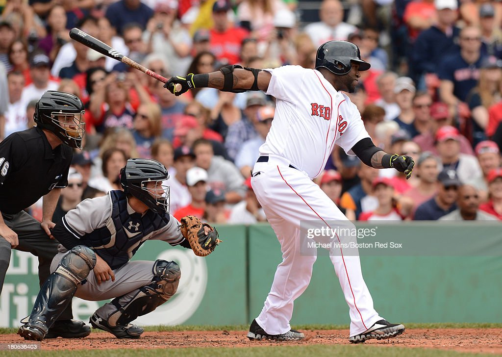 David Ortiz #34 of the Boston Red Sox hits an RBI double against the New York Yankees during the third inning on September 14, 2013 at Fenway Park in Boston Massachusetts.