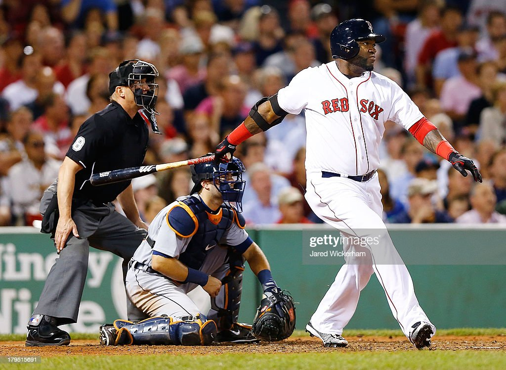<a gi-track='captionPersonalityLinkClicked' href=/galleries/search?phrase=David+Ortiz&family=editorial&specificpeople=175825 ng-click='$event.stopPropagation()'>David Ortiz</a> #34 of the Boston Red Sox hits an RBI double in the 6th inning against the Boston Red Sox for his 2,000th career hit during the game on September 4, 2013 at Fenway Park in Boston, Massachusetts.