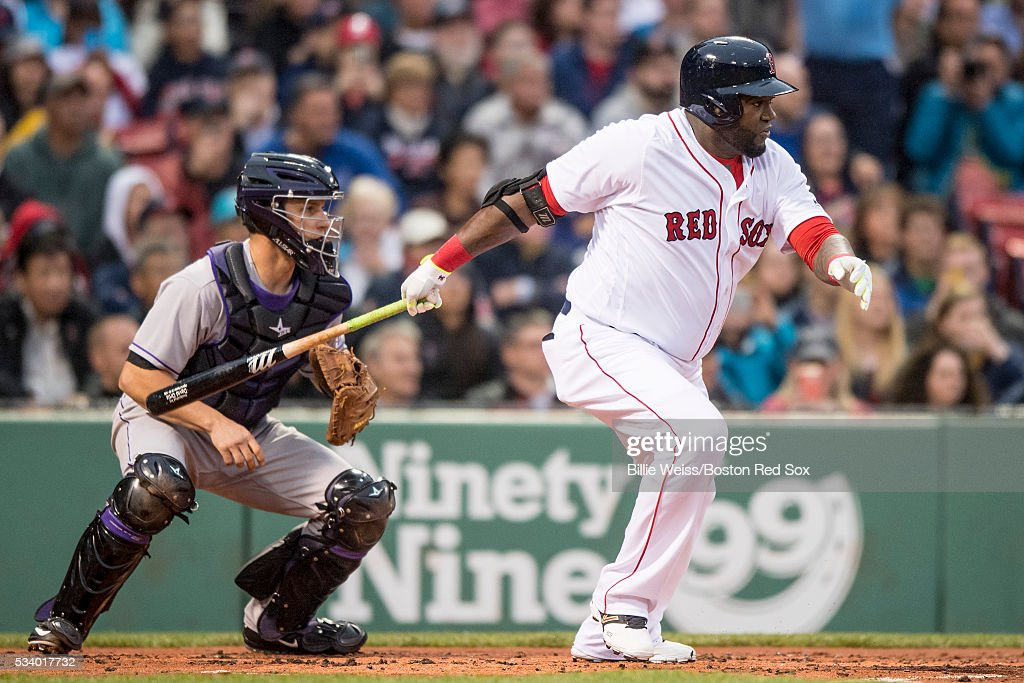 David Ortiz #34 of the Boston Red Sox hits an RBi single during the first inning of a game against the Colorado Rockies on May 24, 2016 at Fenway Park in Boston, Massachusetts.