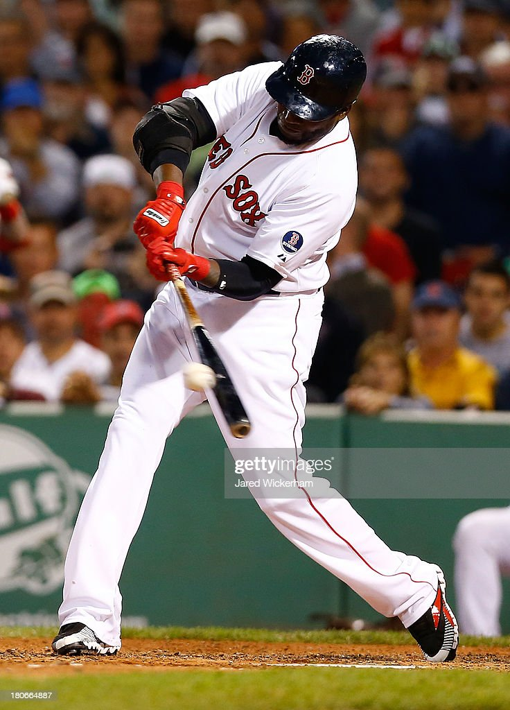 David Ortiz #34 of the Boston Red Sox hits an RBI single in the 6th inning against the New York Yankees during the game on September 15, 2013 at Fenway Park in Boston, Massachusetts.
