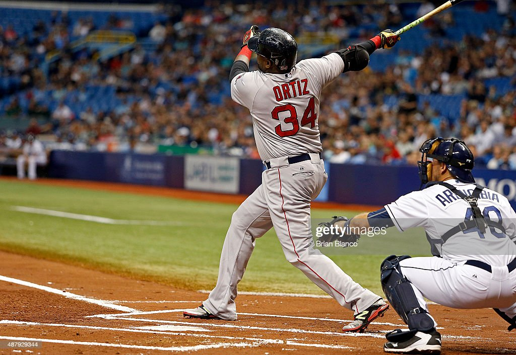 David Ortiz #34 of the Boston Red Sox hits his 499th career MLB home run, a three-run home run in front of catcher J.P. Arencibia #40 of the Tampa Bay Rays, during the first inning of a game on September 12, 2015 at Tropicana Field in St. Petersburg, Florida.