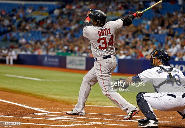 David Ortiz of the Boston Red Sox hits his 499th career MLB home run a threerun home run in front of catcher JP Arencibia of the Tampa Bay Rays...