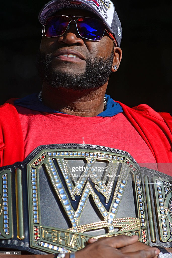 David Ortiz #34 of the Boston Red Sox holds a WWE Championship Belt that was sent to him by John Cena during the river portion of a victory parade on November 2, 2013 through Boston, Massachusetts.