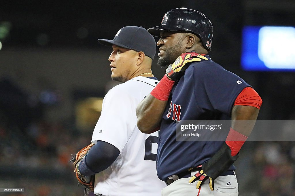 David Ortiz of the Boston Red Sox holds his left shoulder during the seventh inning of the game against the Detroit Tigers on August 19 2016 at...