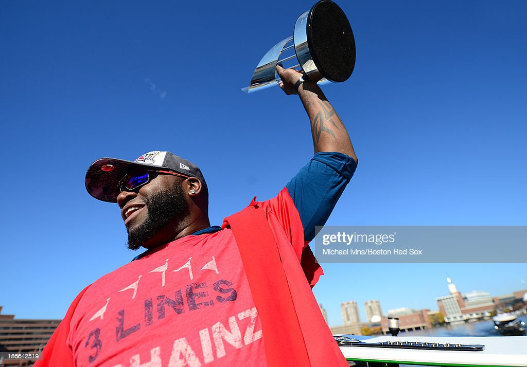 David Ortiz #34 of the Boston Red Sox holds up his World Series MVP trophy during a victory parade on November 2, 2013 through Boston, Massachusetts.
