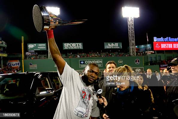 David Ortiz of the Boston Red Sox holds up the MVP trophy following a 61 victory over the St Louis Cardinals in Game Six of the 2013 World Series at...