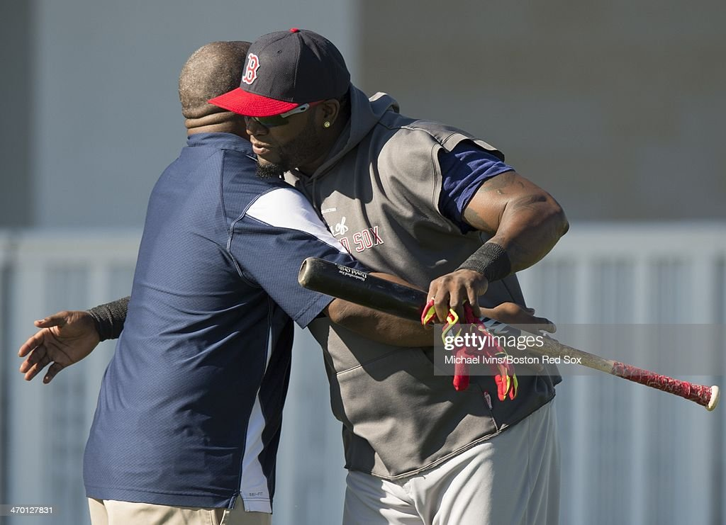 David Ortiz #34 of the Boston Red Sox hugs Clubhouse Attendant Edward 'Pookie' Jackson during a Spring Training workout at Fenway South on February 18, 2014 in Fort Myers, Florida.