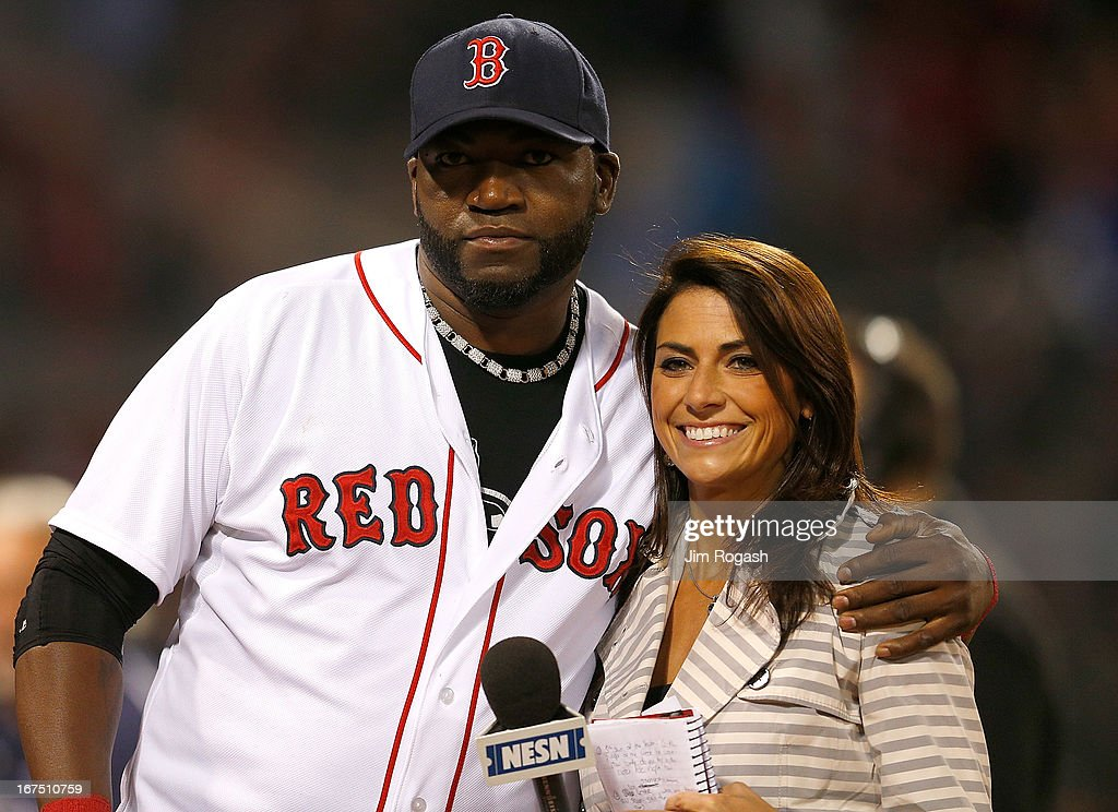 David Ortiz #34 of the Boston Red Sox hugs NESN reporter Jenny Dell after a 7-2 win over the Houston Astros at Fenway Park on April 25, 2013 in Boston, Massachusetts.