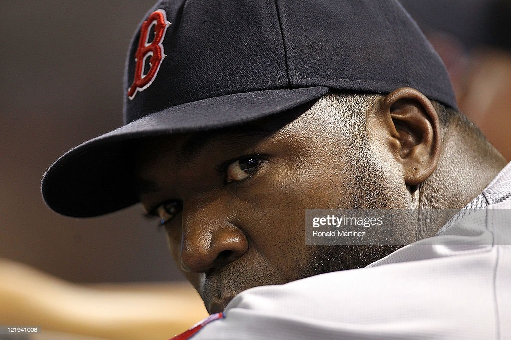 <a gi-track='captionPersonalityLinkClicked' href=/galleries/search?phrase=David+Ortiz&family=editorial&specificpeople=175825 ng-click='$event.stopPropagation()'>David Ortiz</a> #34 of the Boston Red Sox in the dugout at Rangers Ballpark in Arlington on August 23, 2011 in Arlington, Texas.