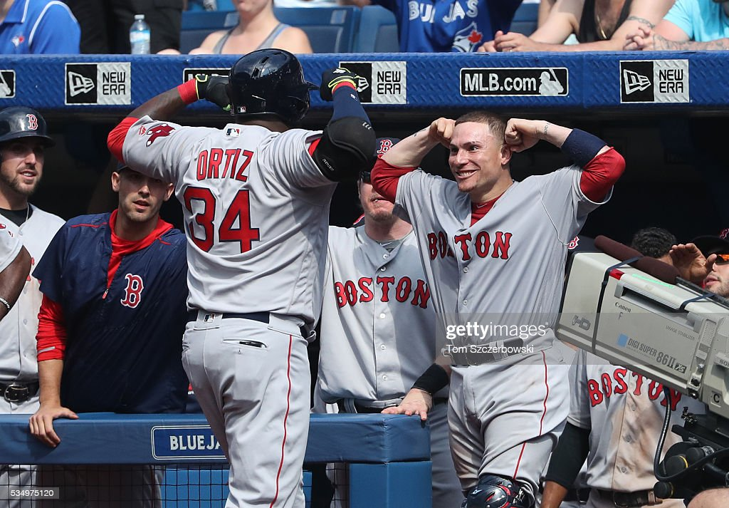 <a gi-track='captionPersonalityLinkClicked' href=/galleries/search?phrase=David+Ortiz&family=editorial&specificpeople=175825 ng-click='$event.stopPropagation()'>David Ortiz</a> #34 of the Boston Red Sox is congratulated by Christian Vazquez #7 after hitting a solo home run in the ninth inning during MLB game action against the Toronto Blue Jays on May 28, 2016 at Rogers Centre in Toronto, Ontario, Canada.