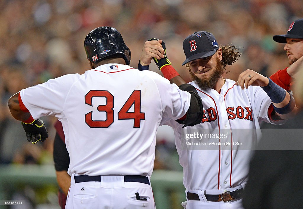 David Ortiz #34 of the Boston Red Sox is congratulated by Jarrod Saltalamacchia #39 after hitting his second home run of the game against David Price #14 of the Tampa Bay Rays during the eighth inning of game two of the American League Division Series on October 5, 2013 at Fenway Park in Boston, Massachusetts.