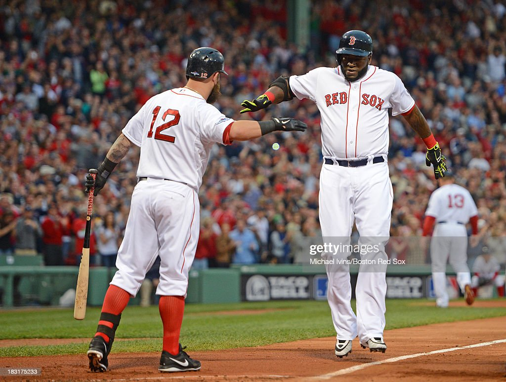 David Ortiz #34 of the Boston Red Sox is congratulated by Mike Napoli #12 after hitting a home run against David Price #14 of the Tampa Bay Rays during the first inning of game two of the American League Division Series on October 5, 2013 at Fenway Park in Boston, Massachusetts.
