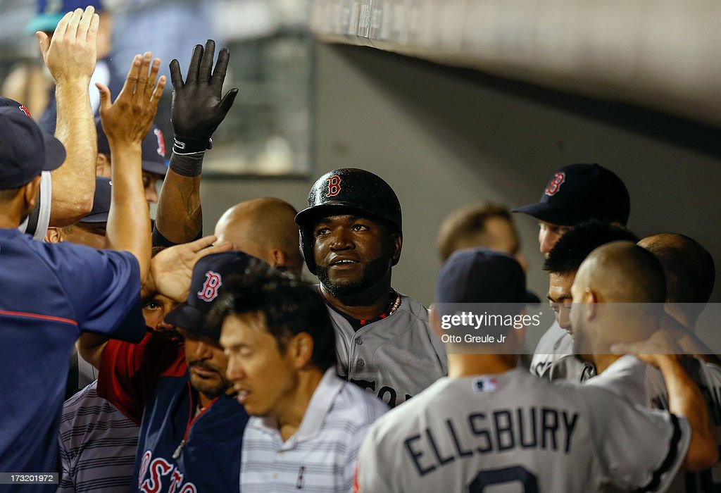 <a gi-track='captionPersonalityLinkClicked' href=/galleries/search?phrase=David+Ortiz&family=editorial&specificpeople=175825 ng-click='$event.stopPropagation()'>David Ortiz</a> #34 of the Boston Red Sox is congratulated by teammates after scoring on an RBI single by Jose Iglesias in the eighth inning against the Seattle Mariners at Safeco Field on July 9, 2013 in Seattle, Washington.