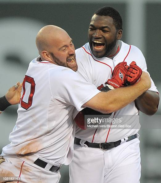 David Ortiz of the Boston Red Sox is embraced by Kevin Youkilis after hitting a gamewinning double against the Detroit Tigers in the ninth inning on...